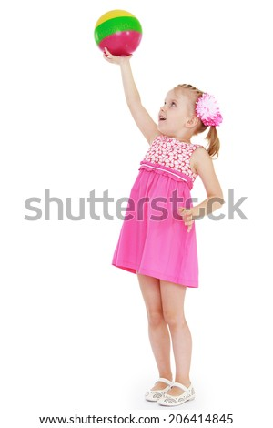 The girl with the ball on white background.happy childhood, carefree childhood concept. - stock photo