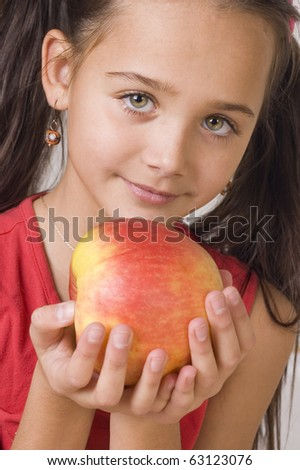 The girl with the big apple in hands. - stock photo