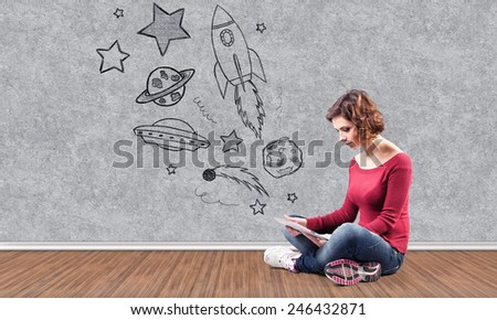 The girl with the computer dreams about cosmos - stock photo