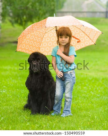 the girl with the dog under an umbrella - stock photo