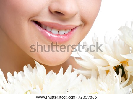 the girl with the flowers close up - stock photo