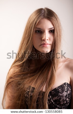 The girl with the golden hair posing in studio