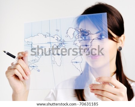 The girl with the map of the world printed on a transparent material - stock photo