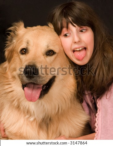 The girl with the sheep-dog - stock photo