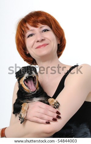 The girl with the small dog at which is opened a mouth - stock photo