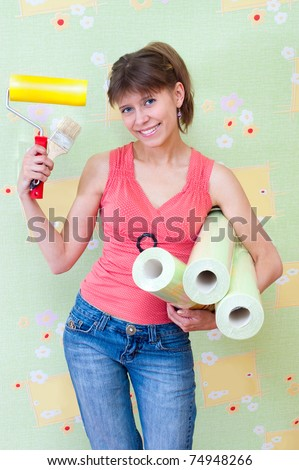 The girl with the wallpaper in the hands of - stock photo