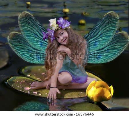 The girl with wings sits on a leaf in water - stock photo