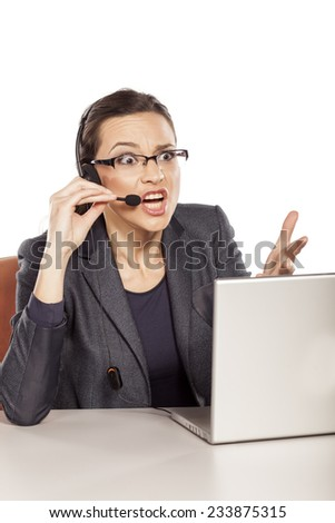 The girl working in the call center and nervously explains - stock photo