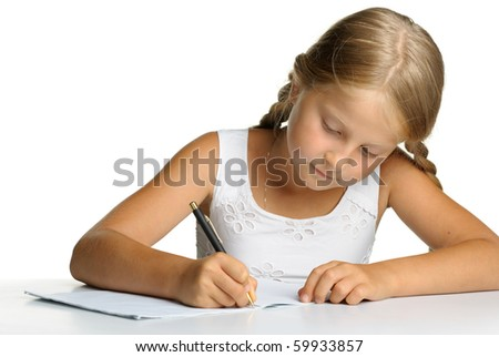 The girl writes to writing-books. The decision of lessons. It is isolated on a white background - stock photo