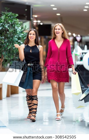 The girls enjoy shopping in the store. It's a very happy day
