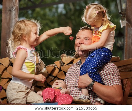 The girls feeds the man with a berry - stock photo
