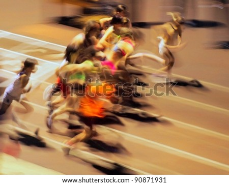 The girls ran out from the start (motion blur). - stock photo