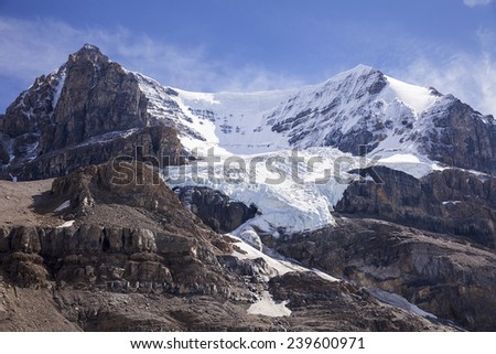 The glacier on Mt Andromeda in Alberta, Canada is formed by snow and ice falling into the funnel formed by the steep slopes of the main bowl. The glacier has been retreating over the last forty years. - stock photo