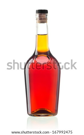 The glass bottle of cognac isolated on white - stock photo