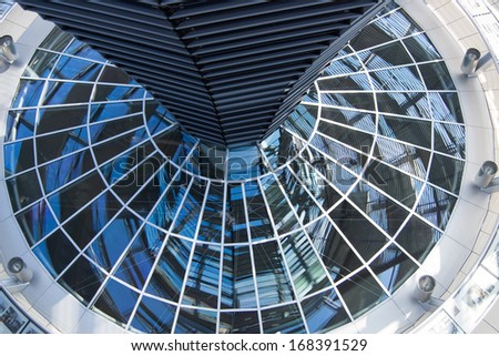The glass dome of the German Reichstag - stock photo