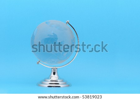 The glass globe. It is isolated on a dark blue background