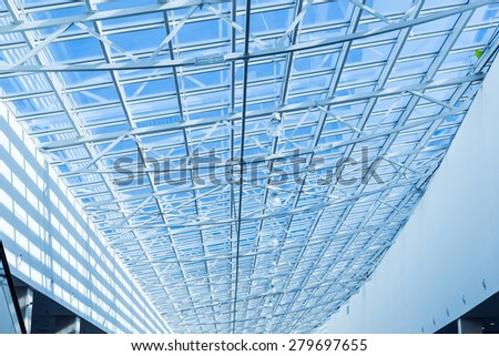 The glass roof of the station in the sunlight. - stock photo