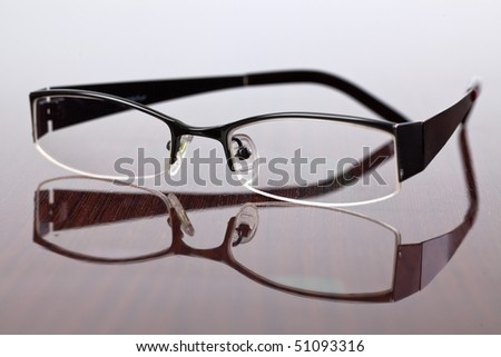the glasses on wooden table - stock photo