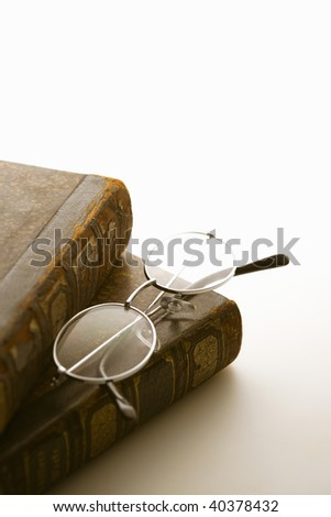 The glasses placed on the thick book.