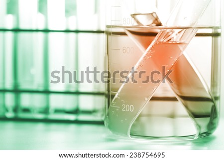 the glassware, beaker and test tubes in laboratory room.