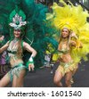 The glittering Brazilian carnival transforming the streets of Islington, London and immerse on-lookers in the sizzling atmosphere of Rio Carnival. - stock photo