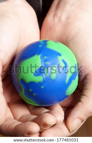 The globe is in the hands of a safe person. - stock photo