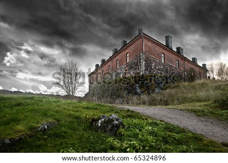 The gloomy ancient house - stock photo