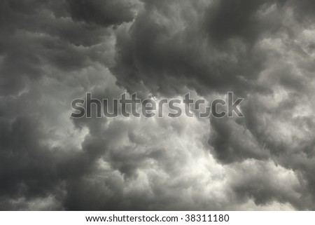 The gloomy sky preceding a storm with dark clouds background - stock photo