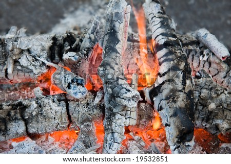the glow of embers, close up photo - stock photo