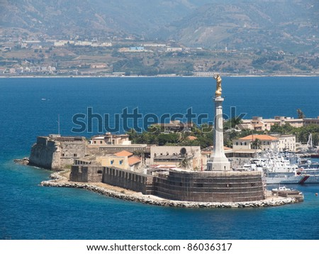 "the gold ""Madonna della Lettera"" statue at the entrance of the Messina's port, Calabria coastline in the background - Italy"