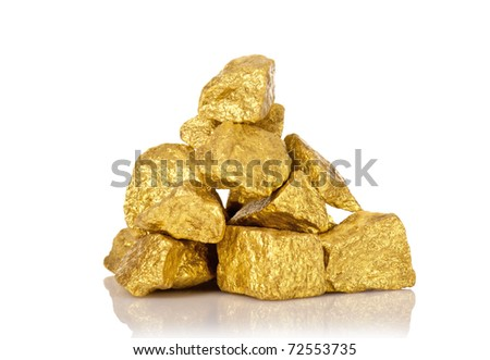 The gold nuggets isolated on white - stock photo