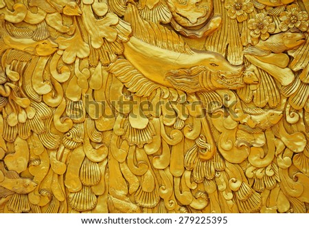 The gold stucco design of native thai style on the Wall - stock photo