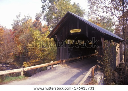 The Goldbrook Covered Bridge in Stowe, Vermont during the winter - stock photo
