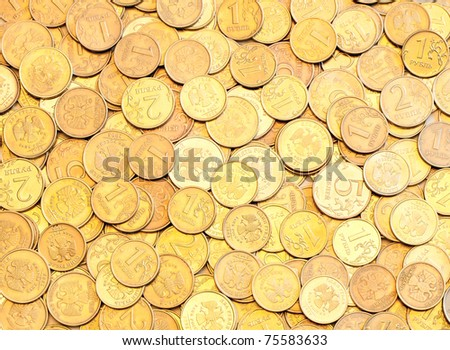 The golden background of the coins different sizes - stock photo
