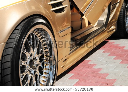 The golden car with an open door - stock photo