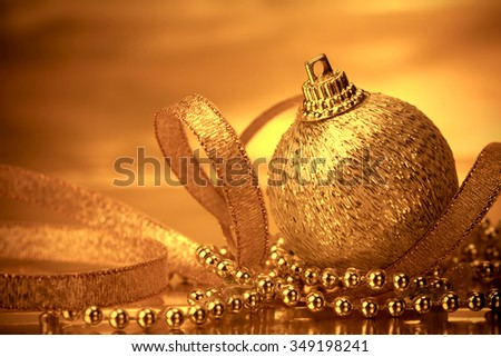 the golden christmas ball decorations for celebration background - stock photo