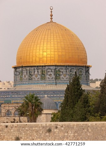 The golden Dom on the temple ground in Jerusalem, in foreground the wailing, western wall. - stock photo