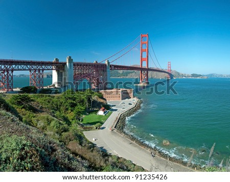 The Golden Gate Bridge in San Francisco during the sunny day with beautiful azure ocean in background - stock photo