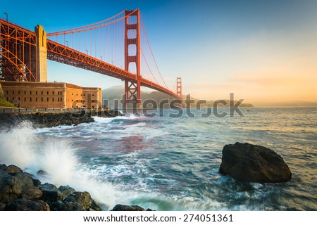 The Golden Gate Bridge, seen at sunrise from Fort Point, San Francisco, California. - stock photo