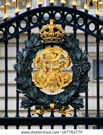 The golden gates of Buckingham Palace home of the British Monarchy in London England - stock photo
