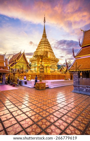 the golden pagoda in twilight of wat phra that doi suthep . The most famous temple in chiangmai ,Thailand - stock photo