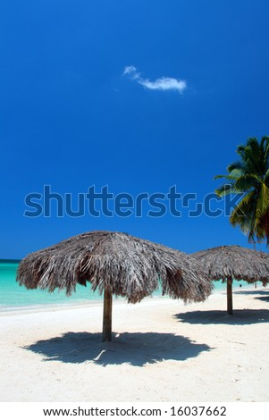 The golden sands of Seven Mile Beach are located on the shores of Negril. This butterscotch beach is hugged by a bow-shaped town, and is the longest continuous stretch of powdery beach on Jamaica. - stock photo