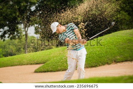 The golf course is on the sand. Sand making splashes - stock photo