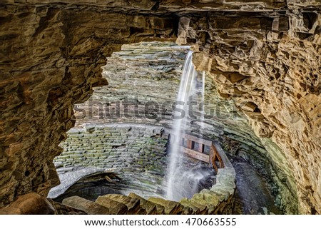 The Gorge Trail goes behind Cavern Cascade and into a rocky cave at New York's Watkins Glen State Park.