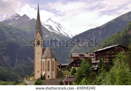 The gothic pilgrimage church of Saint Vincent in Heiligenblut in Austria - stock photo