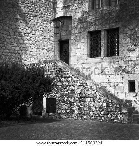 The gothic Wawel Castle in Krakow, Poland. 6x6, black & white - stock photo