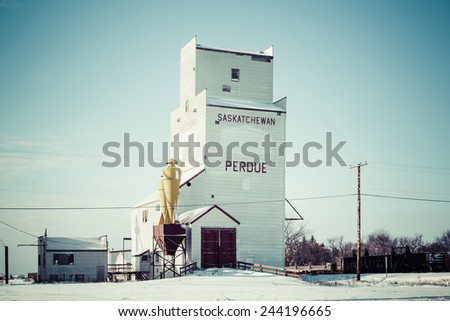 The grain elevator in Perdue, Saskatchewan, Canada on a cold but sunny winter day. - stock photo