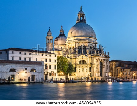 The Grand Canal in the evening with the Santa Maria della Salute cathedral in the city of Venice in Italy - stock photo