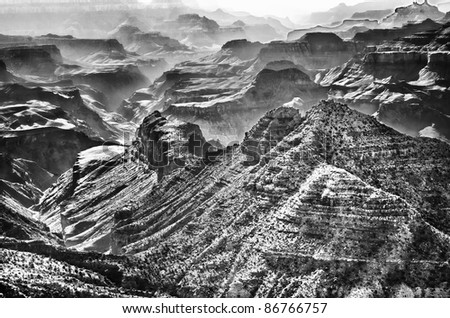 The Grand Canyon in black and white with smoke and smog between the walls of the canyon. - stock photo