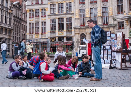 The Grand Palace of Brussels, Belgium - June 25,2013 : Teacher and children on a field trip - stock photo